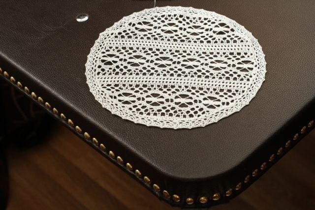 Napkin of round machine made lace 25 cm