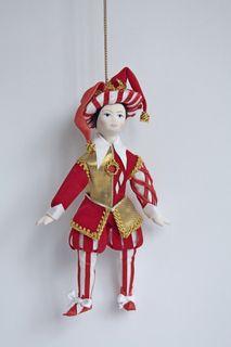 Doll pendant souvenir porcelain. A joke based on Bakst.