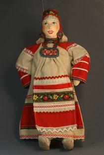Souvenir doll Akulina in a traditional festive costume. Russia