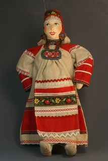 Souvenir doll Akulina in a traditional festive costume. Russia