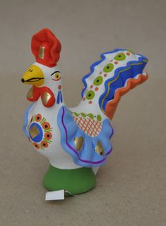 Cock with a blue long tail, Dymkovo clay toy