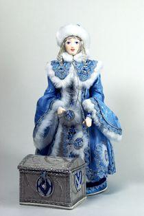 Porcelain souvenir doll. Snow Maiden with a chest. Fairytale character.