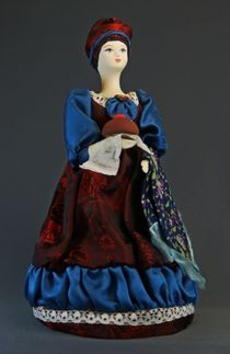 Doll gift porcelain. Woman with Easter hot cross.19th century. Russia