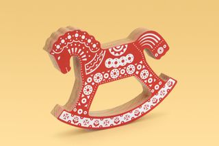 Wooden horse toy, rocking horse with an ornament, red