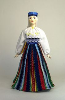 The girl at the Estonian national costume. Doll gift