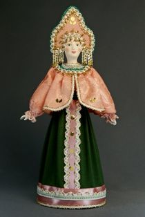 Porcelain doll in Russian stylized costume