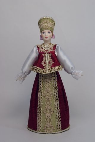 Doll gift porcelain. Arhangelskaya lips. Russia. Maiden costume . Late 19th - early 20th century.