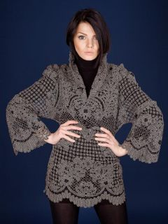 Blouse women's lace with ornaments from the branches with flowers