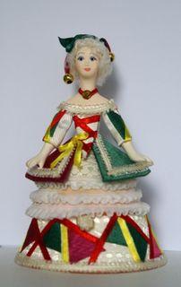 Doll box in secular costume.