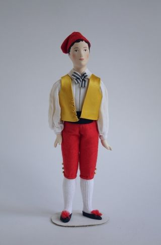 Doll gift. The male costume of the 19th century. Italy. Naples.