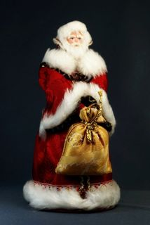 Doll gift porcelain. Santa Claus in a boyar's fur coat. Fairy tale character.