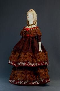 Doll gift porcelain. A lady in a ball gown. The middle of the 19th century. Europe.