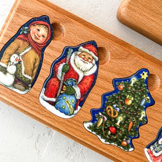 "A set of Christmas tree decorations in a wooden box ""magic heroes"""