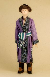 Doll gift porcelain. Suit Kasimov Tatar. Late 19th - early 20th century.