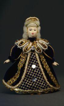 Doll pendant souvenir porcelain. Queen grandmother.