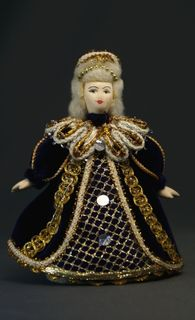 Doll pendant souvenir porcelain. Queen grandmother.