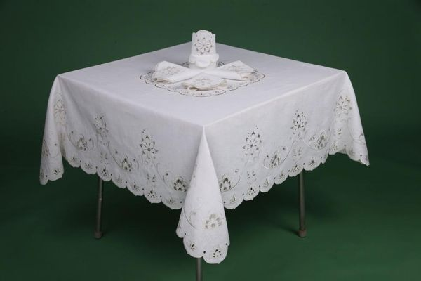 The tablecloth has embroidery cutwork