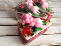 Handmade soap Sweetart in the form of cake with a gorgeous pig instead of cherries
