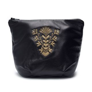 "Leather cosmetic bag ""the First rays"" of black color with Golden embroidery"