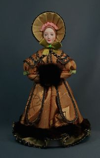 Doll gift porcelain. Lady in city winter clothes with a clutch. The middle of the 19th century