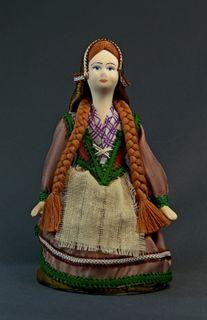 Doll gift porcelain. Girl in national costume. 19th century. France.