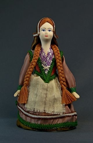 Doll gift porcelain. Girl in national costume. 19th century. France.