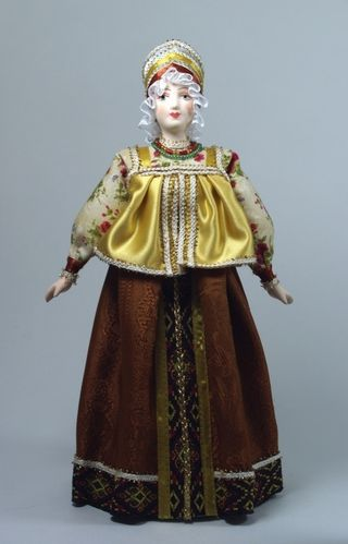 Doll gift porcelain. Siberia. Russia. Women's festive costume. The beginning of the 20th century.