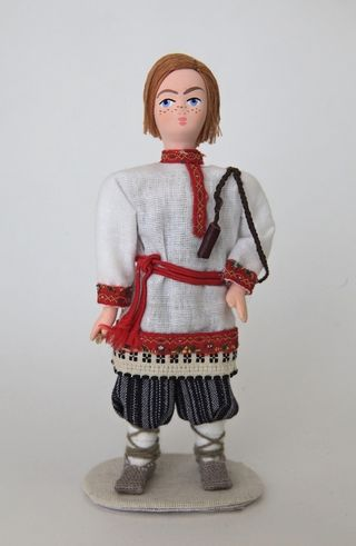 Doll gift porcelain. Russia. The Archangel's lips. Kids costume. Late 19th - early 20th century.
