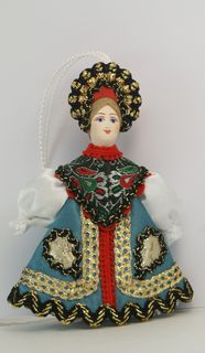 Doll pendant souvenir porcelain. Russian beauty.