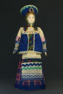 Doll gift porcelain. The North Of Russia. Girl in formal attire. Late 19th - early 20th century.