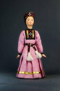 Doll gift porcelain. Astrakhan lips. Russia. Kalmyk festive costume girl.