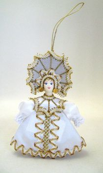 Doll pendant souvenir porcelain. Snowflake. Fairy tale character.