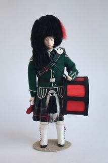 """Doll gift. The Scot is the drummer, """"Scottish national orchestra"""". The contemporary costume of the 21st century. Scotland."""
