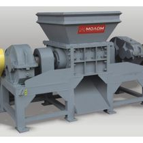 Two-shaft shredder for shredding wood waste and producing wood chips or recycling industrial waste