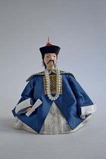 Doll gift. The costume of a Mandarin of high rank of the 19th century. China