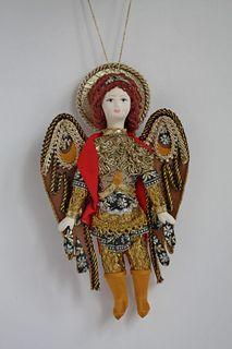 Doll pendant souvenir porcelain. Archangel Michael.