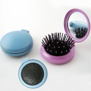 The comb with a mirror is folding