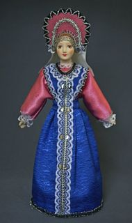 Doll gift porcelain. Traditional maiden costume. Russia.