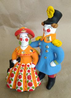 Dymkovo clay toy, the Knight and the lady with the umbrella