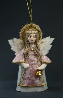 Doll pendant souvenir porcelain. Angel