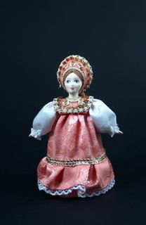 Doll gift porcelain. Russia. Girl in traditional summer clothes.