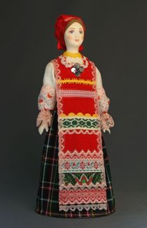 Doll gift. Traditional peasant maiden costume. Russia.