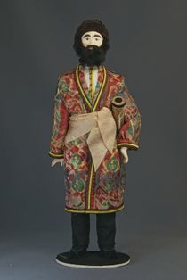 Doll gift porcelain. The costume of the Bukharan Jews with the Torah scrolls. 19th century.