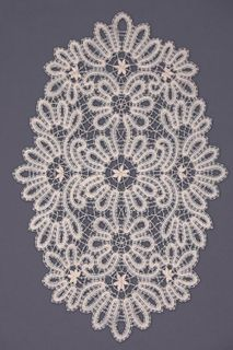 Doily lace oval with stylized vegetable ornament