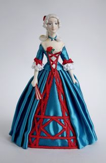 Doll gift. A lady in a masquerade dress. 18th century