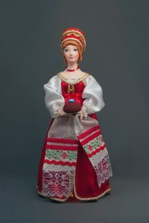 Doll gift porcelain. Woman in North Russia costume traditional loaf.19th century.