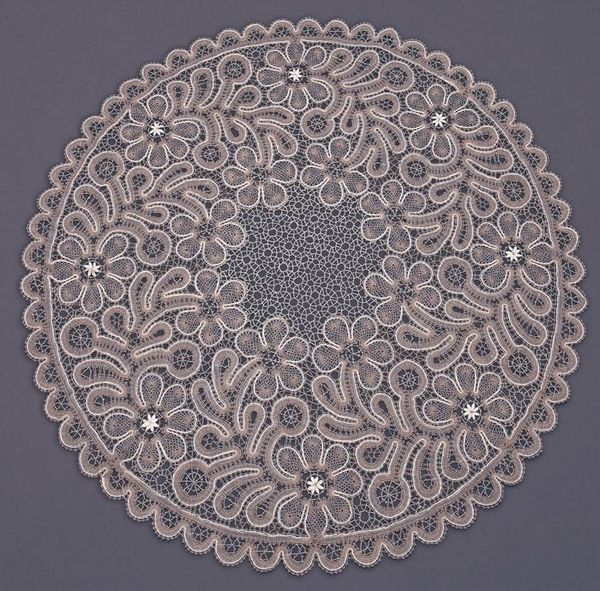 Round lace tablecloth with a pattern of twigs