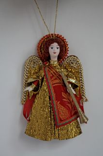 Doll angel with trumpet