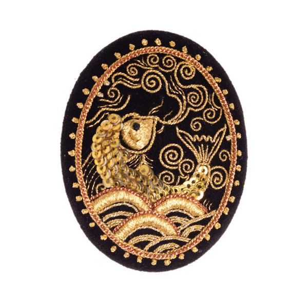 Brooch 'Fish' in black with gold embroidery