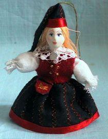 Doll pendant souvenir porcelain. Estonian national costume.